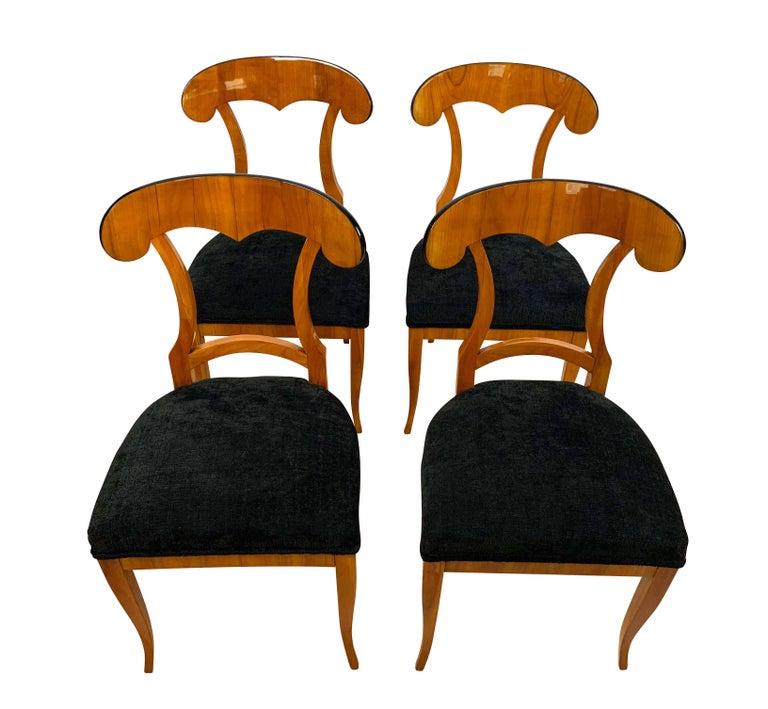 Set of four Biedermeier Shovel chairs, cherry veneer, South Germany, circa 1820  Elegant and comfortable set of four original, rare, neoclassical Biedermeier shovel chairs (scoop shaped back). Friendly, bright cherry wood veneered (shovel and