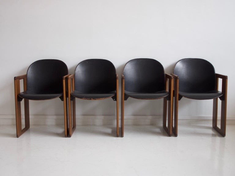 Set of four armchairs with walnut frame and black leather upholstered seat and back. Designed by Afra & Tobia Scarpa for B&B Italy, circa 1970s. Marked by maker.