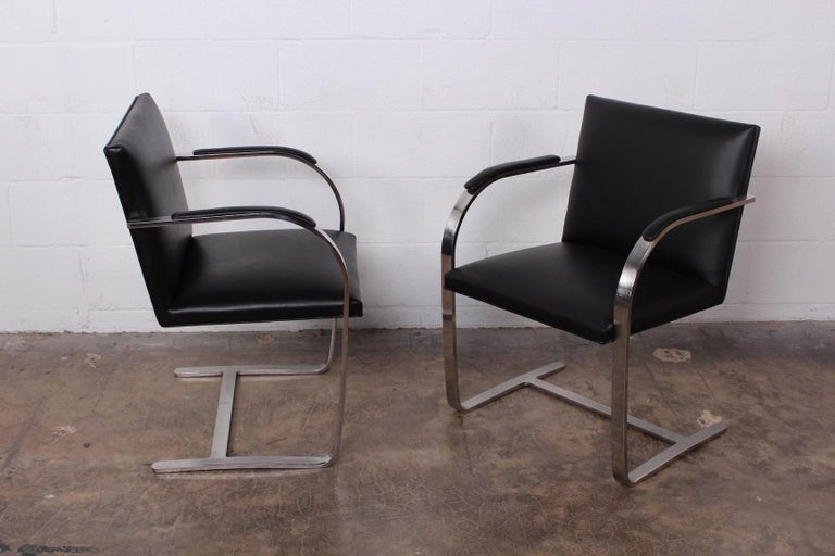 A set of four polished stainless steel and black leather Brno chairs designed by Ludwig Mies van der Rohe for Knoll.