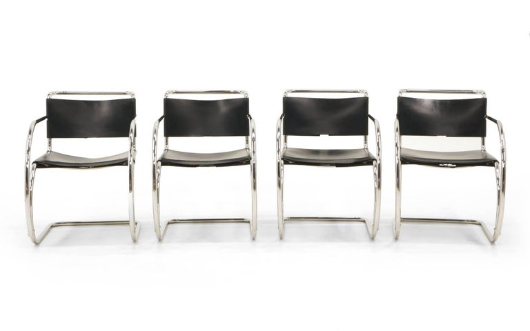 Four Ludwig Mies van der Rohe black leather and chrome tubular steel MR 20 armchairs. Manufactured by Knoll in Italy, these 1960s production are in original condition with only attractive minor wear. Nice examples of this design in a matched set.