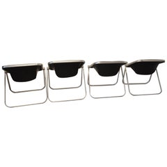 "Set of Four Black Leather ""Plona"" Folding Chairs by Giancarlo Piretti"