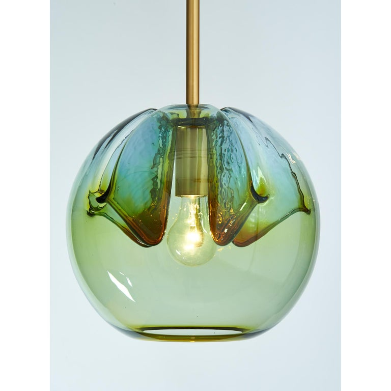 Italy, 1970s Vintage blown colored glass globes, repurposed in our workshops as lanterns, with satin polished brass mounts. Artisanally mouth blown, the ensemble is unified but each globe has its own variation in hues. See last photo for