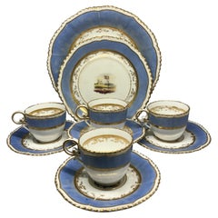 Set of Four Blue and Gilt Painted English Scenes Coffee Cups