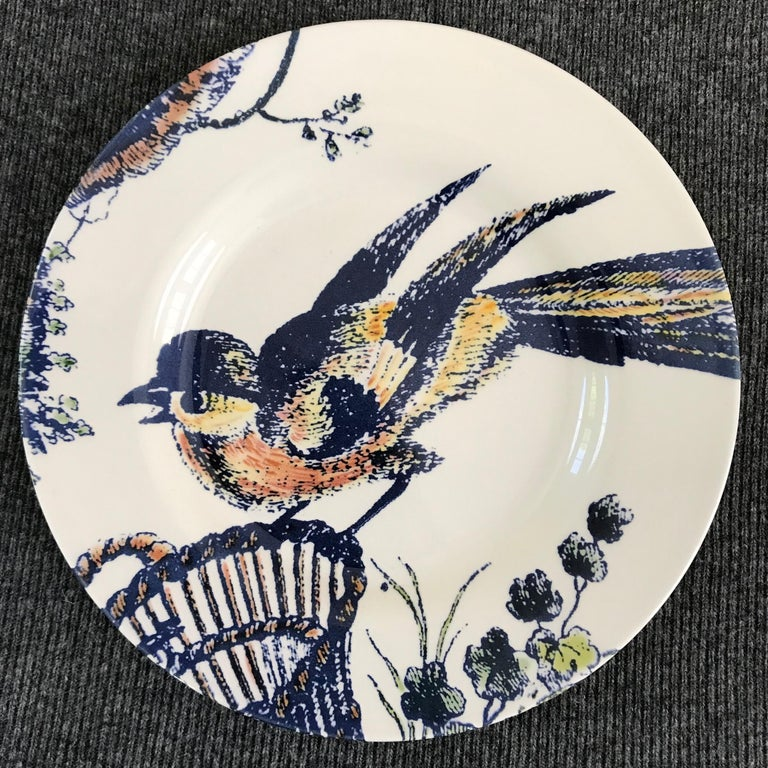 Set of four blue and white bird plates. Four contemporary coloured bird dishes featuring a loon, a rooster, a swan and a kinglet In blues, yellows and peach; a charming avian lunch plate set of four for use or display. Markings for Royal Stafford.