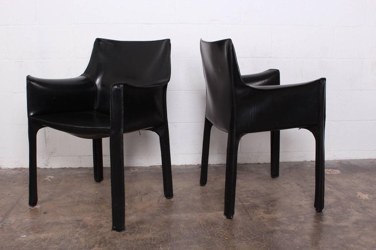 A vintage set of four black leather Cab armchairs designed by Mario Bellini for Cassina.