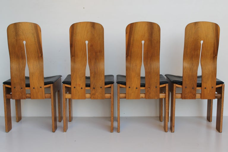 FourCarlo Scarpa walnut and black leather chairs mod. 1934/765 for BERNINI 1977.  765 is planned by Carlo Scarpa in 1934, year from which the chair will take subsequently the name, but it will be produced only in the 1977.  The author realizes