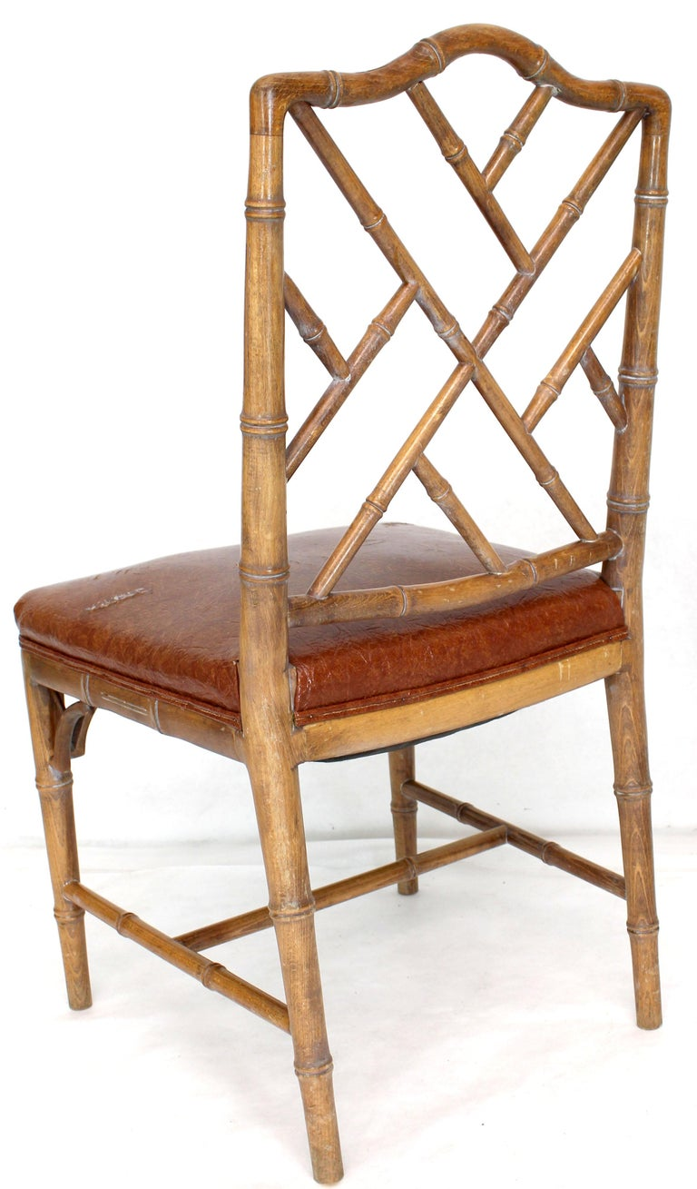 Spring loaded seats set of four quality dining chairs. New upholstery recommended.
