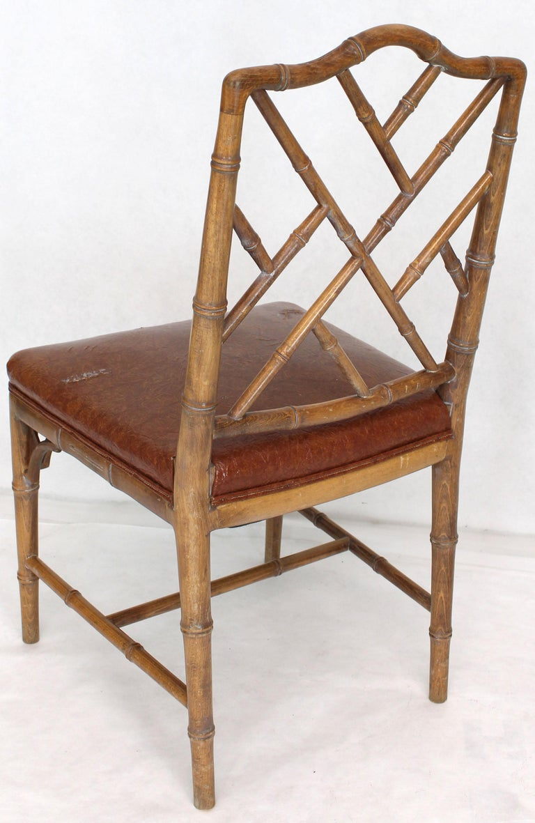 Hardwood Set of Four Carved Faux Bamboo Dining Chairs For Sale