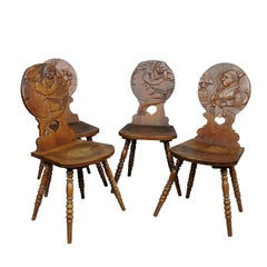 Set of Four Carved Whimsy Black Forest Board Chairs, circa 1900