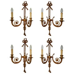Set of Four Cast Bronze Bows and Tassels Sconces, circa 1900