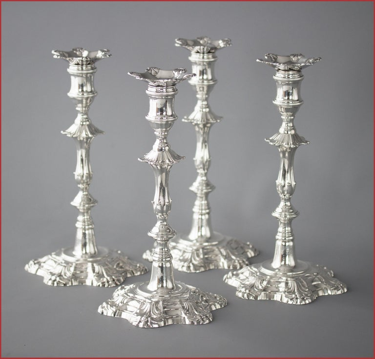 An extremely fine set of cast Silver candlesticks of petal form decoration rising from a stepped, circular, rope twist decorated base to a tapered fluted column beneath a hexagonal knop. The capitals of cotton reel form with rope twist decoration.