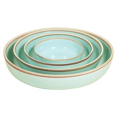Set of Four Celadon Glazed Porcelain Hermit Bowls with Rustic Rim