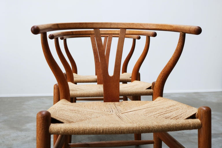 Mid-Century Modern Set of Four CH24 ''Wishbone'' Chairs by Hans J. Wegner Oak Papercord Carl Hansen For Sale