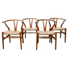 Set of Four CH24 ''Wishbone'' Chairs by Hans J. Wegner Oak Papercord Carl Hansen