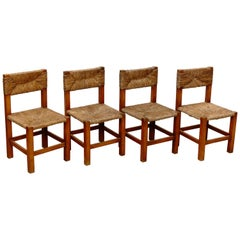 Set of Four Chairs after Charlotte Perriand in Wood and Rattan, circa 1950