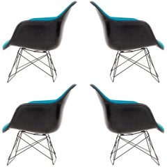 Set of Four Charles Eames LAR Chairs