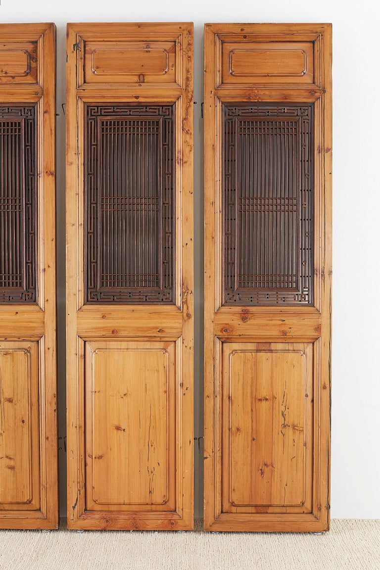 Hand-Carved Set of Four Chinese Carved Elm Lattice Door Panels For Sale