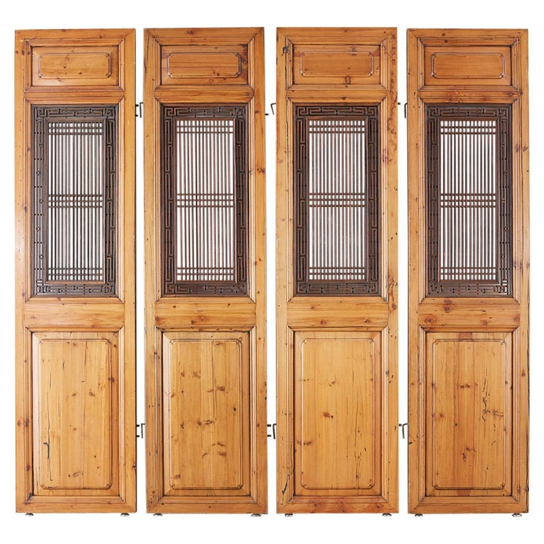 Set of Four Chinese Carved Elm Lattice Door Panels For Sale