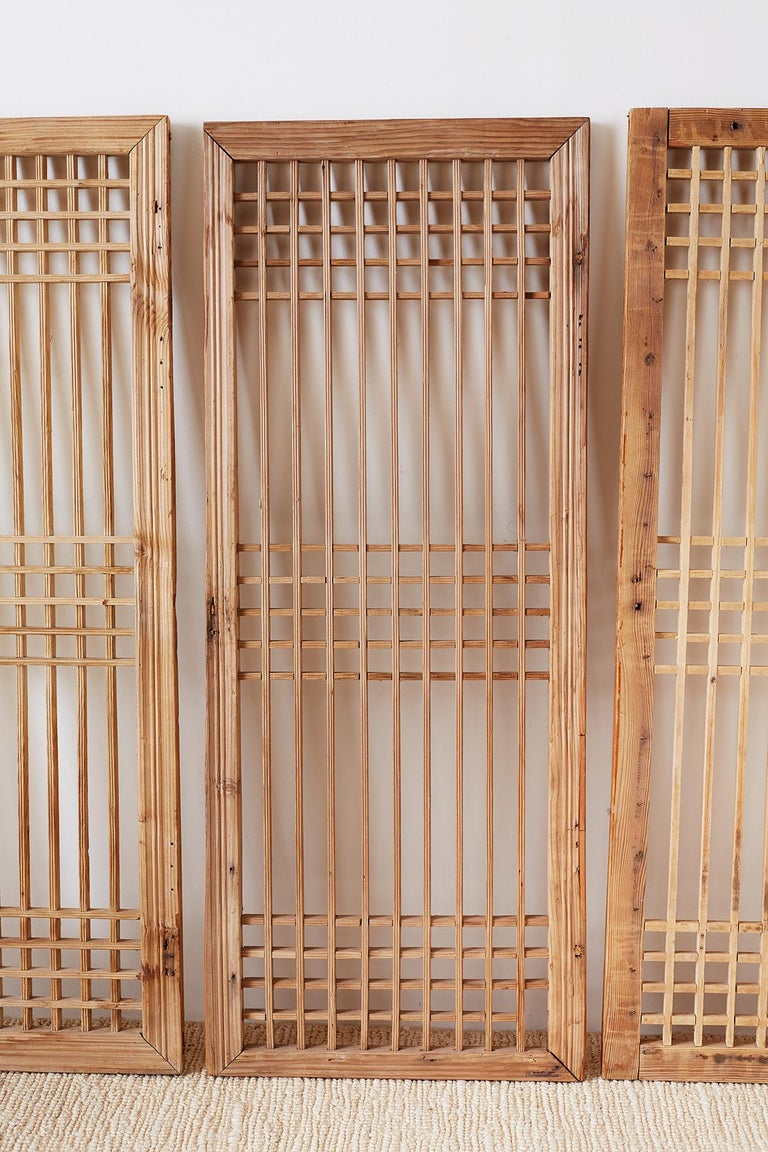 Set of Four Chinese Geometric Lattice Window Panels In Distressed Condition For Sale In Rio Vista, CA