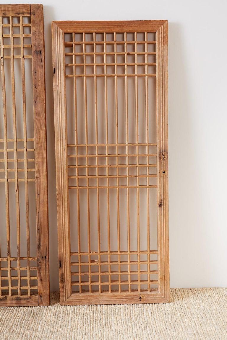 Wood Set of Four Chinese Geometric Lattice Window Panels For Sale