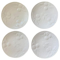 Set of Four circa 1950s White Ceramic Embossed Fruit Plates by Ed Langbein