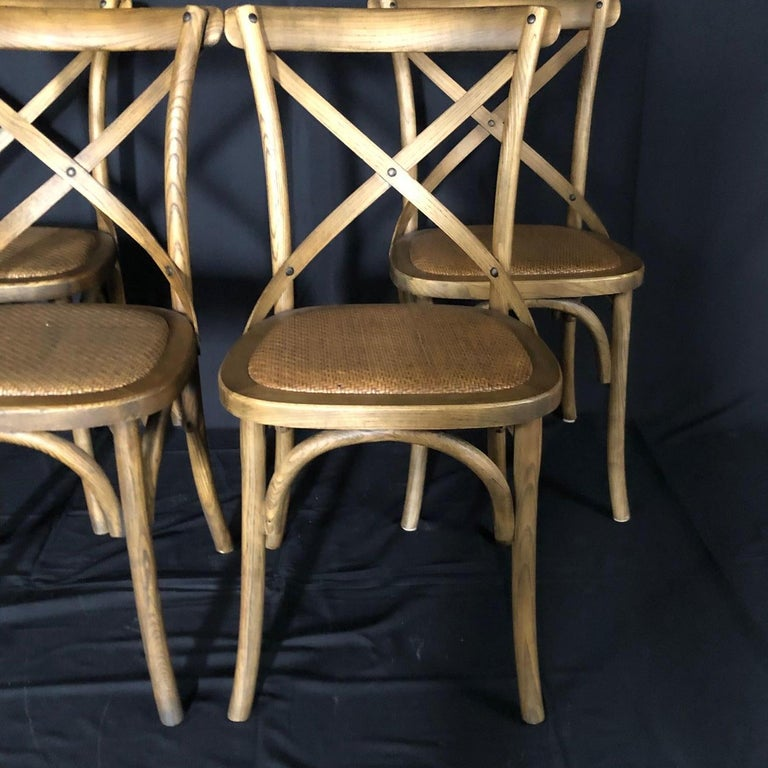 This set of four bentwood French bistro or café chairs have Classic campaign style and beautiful woven caned seats. The bentwood design is Classic and elegant.   #5107.
