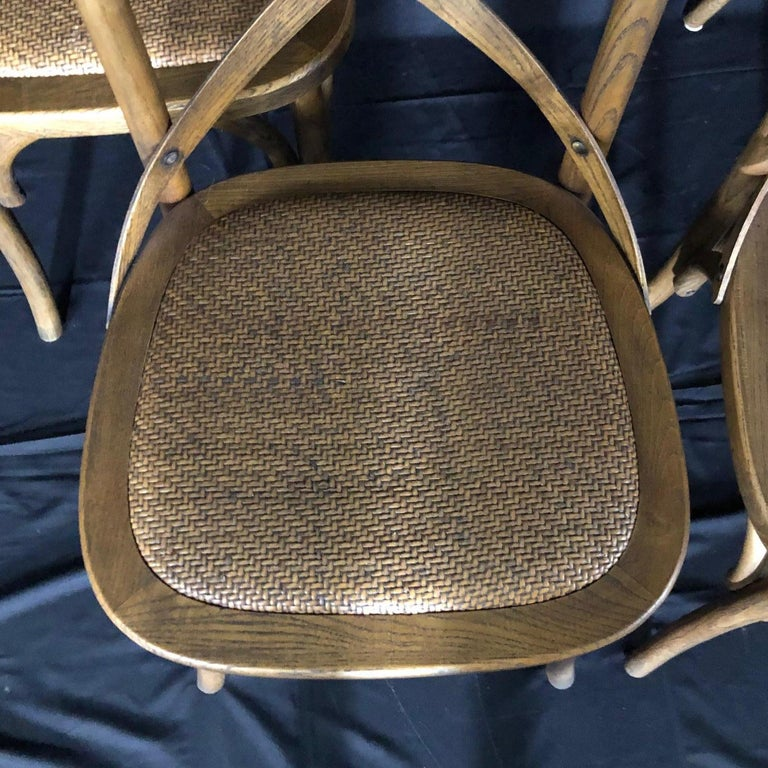 Campaign Set of Four Classic French Bentwood Bistro Chairs with Woven Seats For Sale