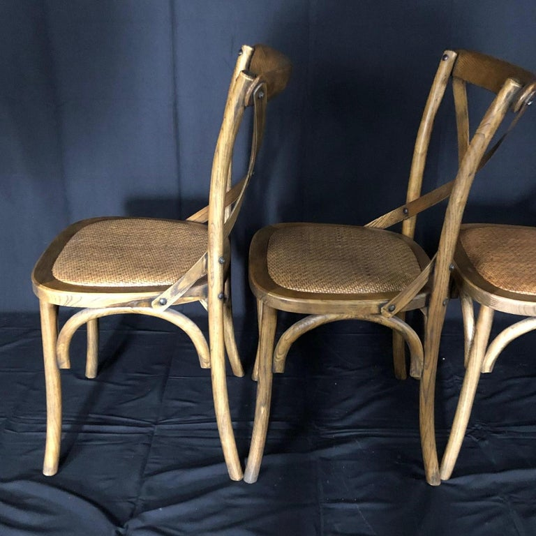 Set of Four Classic French Bentwood Bistro Chairs with Woven Seats For Sale 2