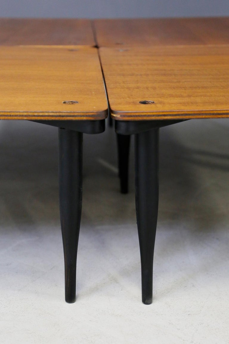 Stackable coffee tables model T8 designed by Vico Magistretti and produced by Azucena, Milan (Italy), 1950. The structure is in solid ebonized wood and the top is in plywood. The feet are conical shaped. They may have slight traces of use due to