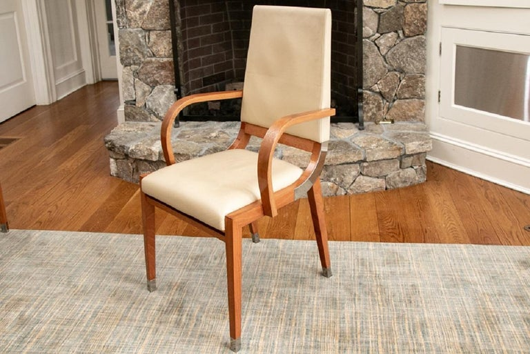 Very well constructed in pale wood with chrome details on the bentwood side frames and square feet. Upholstered in elegant pale leather.  Condition: Good condition with some scrapes to the legs, some smudges to the leather but can be cleaned and
