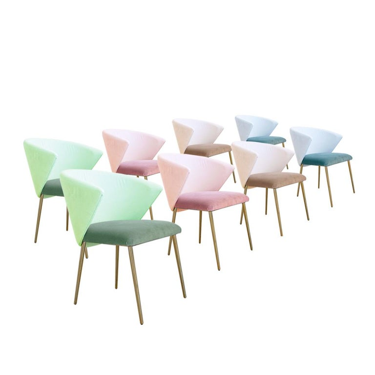 Set of four contemporary modern dining chairs made of solid wood structure and four brass legs. Upholstered in plain cotton velvet in different colour shades . Italian manufacture.