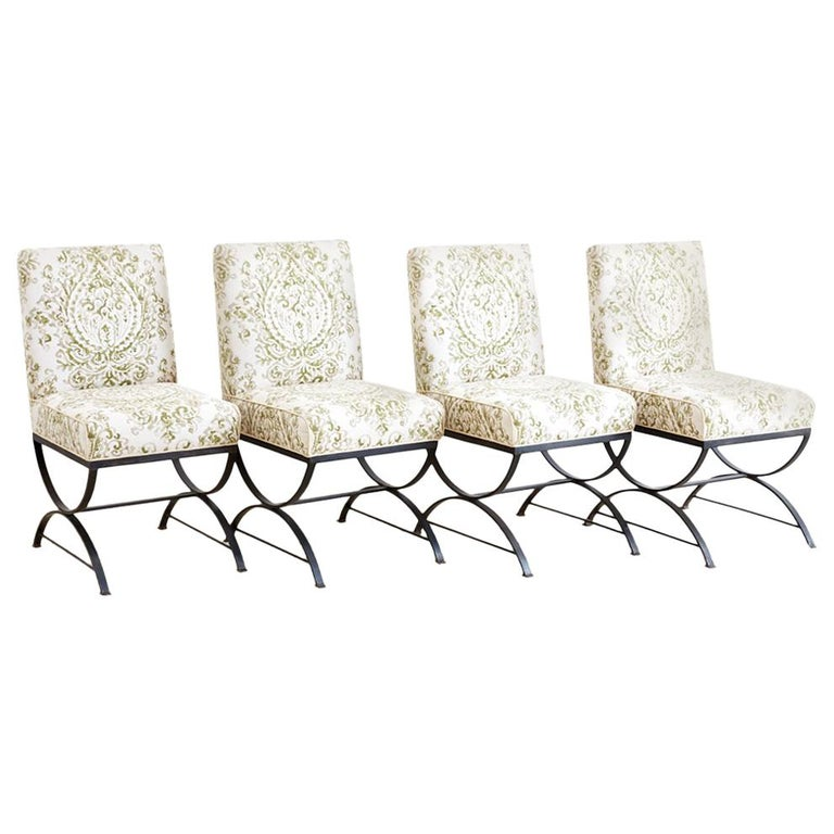 Set of Four Curule Base Wrought Iron Dining Chairs For Sale