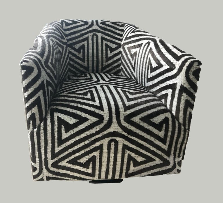 Set of four beautifully designed custom swivel club chairs with woven braided velvet upholstery in a geometric pattern and leather welt detail. 