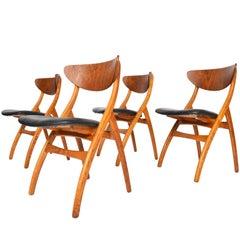 Set of Four Danish Mid-Century Modern Teak and Oak Swag Leg Dining Chairs