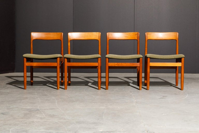 A set of four (4) classic Danish Modern teak side chairs in the style of Niels O. Møller for J.L. Møllers Møbelfabrik. The teak frames with curved seat backs are elegant and sophisticated, original fabric upholstered seats are ready for reupholstery