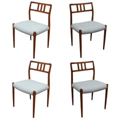 Set of Four Danish Teak Dining Chairs # 64 by J L Moller With Spinneybeck Seats