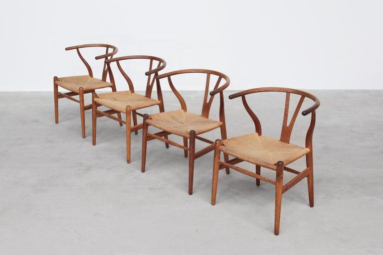 Set of Four Danish Wishbone Chairs CH 24 by Hans J. Wegner for Carl Hansen Oak For Sale 6