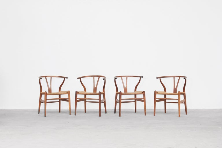 A set of four beautiful and original wishbone chairs designed by Hans J. Wegner and produced by Carl Hansen in the 1960s in Denmark. All chairs are made out of oak and in original condition with signs of usage.  We have six more of this model in