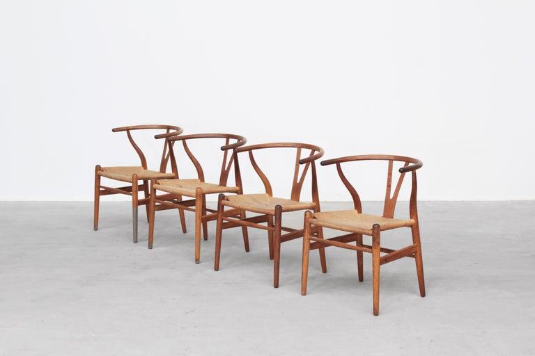 20th Century Set of Four Danish Wishbone Chairs CH 24 by Hans J. Wegner for Carl Hansen Oak For Sale