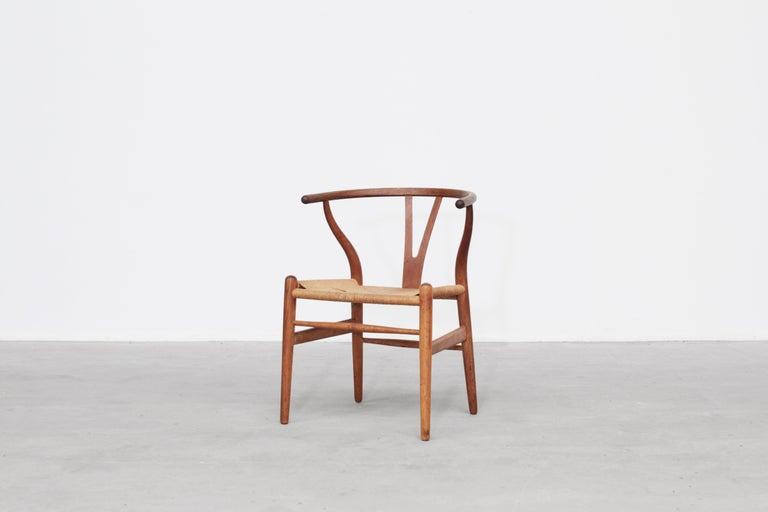 Set of Four Danish Wishbone Chairs CH 24 by Hans J. Wegner for Carl Hansen Oak For Sale 1