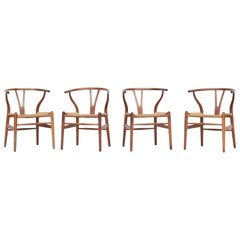 Set of Four Danish Wishbone Chairs CH 24 by Hans J. Wegner for Carl Hansen Oak