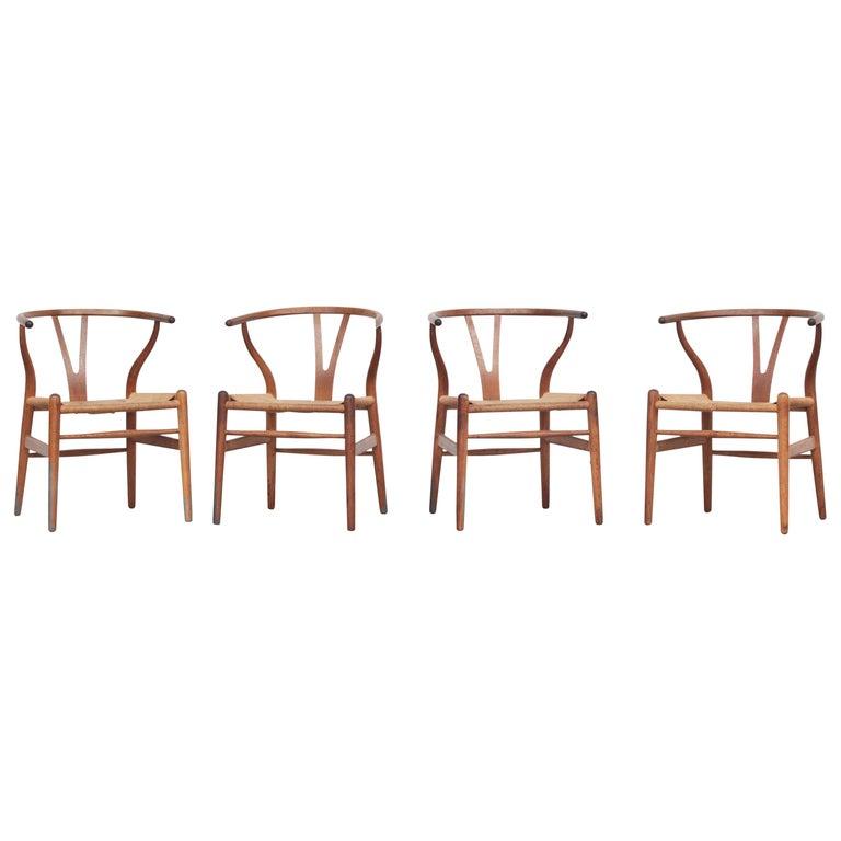 Set of Four Danish Wishbone Chairs CH 24 by Hans J. Wegner for Carl Hansen Oak For Sale