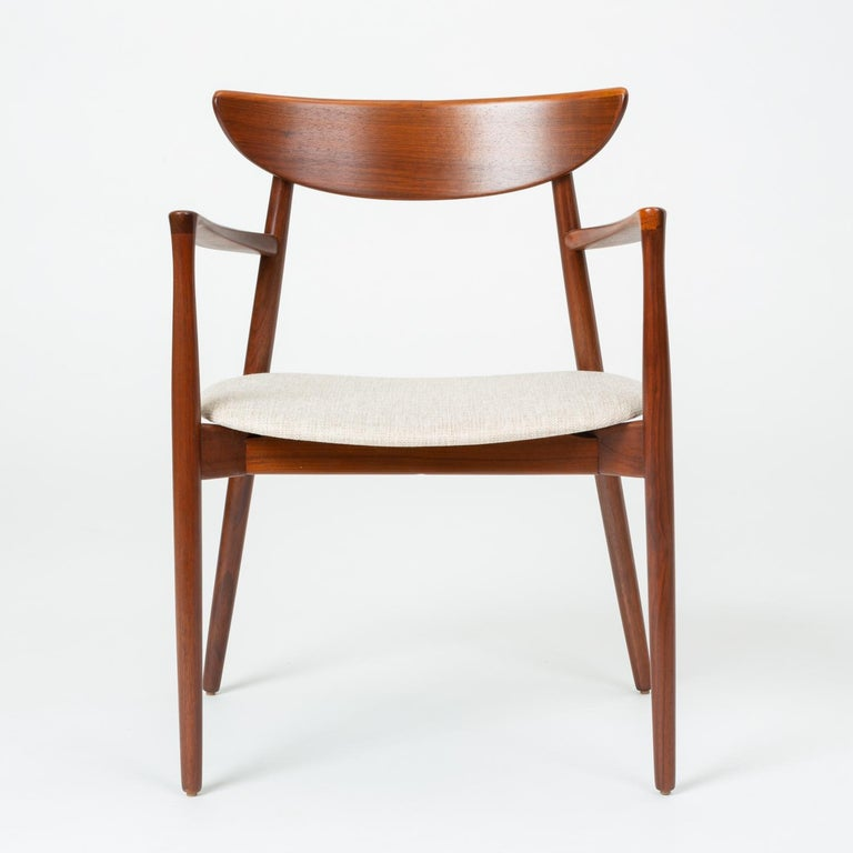 Designed circa 1960 by Harry Østergaard, this set of dining chairs includes two arm chairs and two side chairs. Manufactured in Denmark by Randers Møbelfabrik, the chairs were imported, like many other Randers designs, by the Long Beach-based