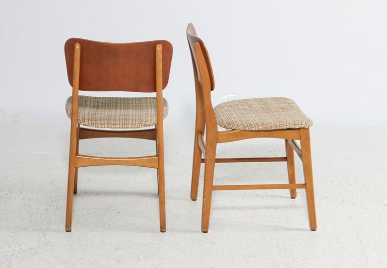 Beech frame, upholstered seat and teak backrest.