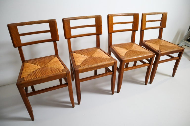 Mid-Century Modern Set of Four Dining Chairs by Pierre Cruege in Oak and Cane, France, 1940s For Sale