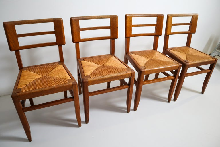 Set of Four Dining Chairs by Pierre Cruege in Oak and Cane, France, 1940s In Good Condition For Sale In Almelo, NL