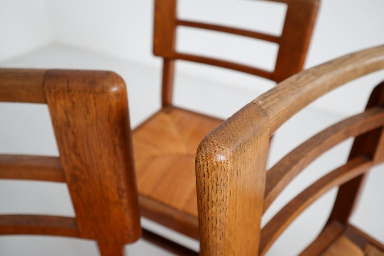 20th Century Set of Four Dining Chairs by Pierre Cruege in Oak and Cane, France, 1940s For Sale