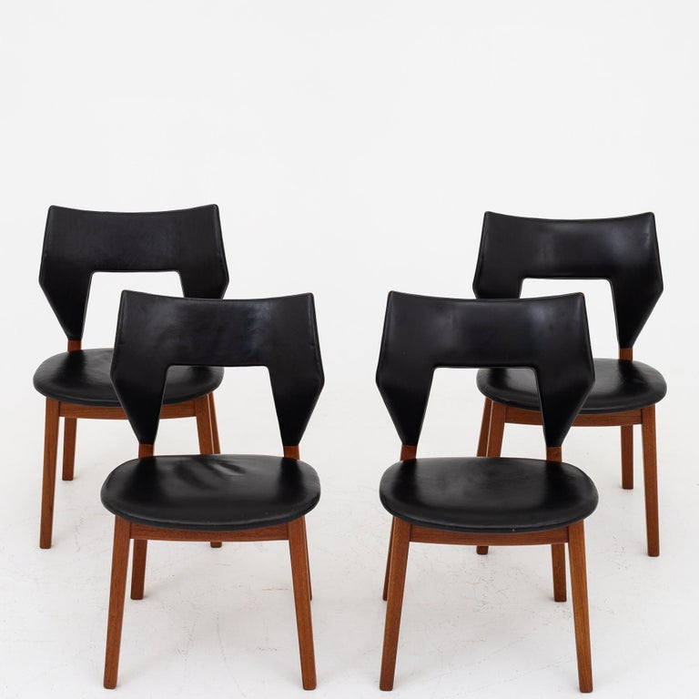 Set of 4 dining chairs with frame of teak and seat and back in black, patinated leather. Designed in 1960. Maker Thorald Madsen.
