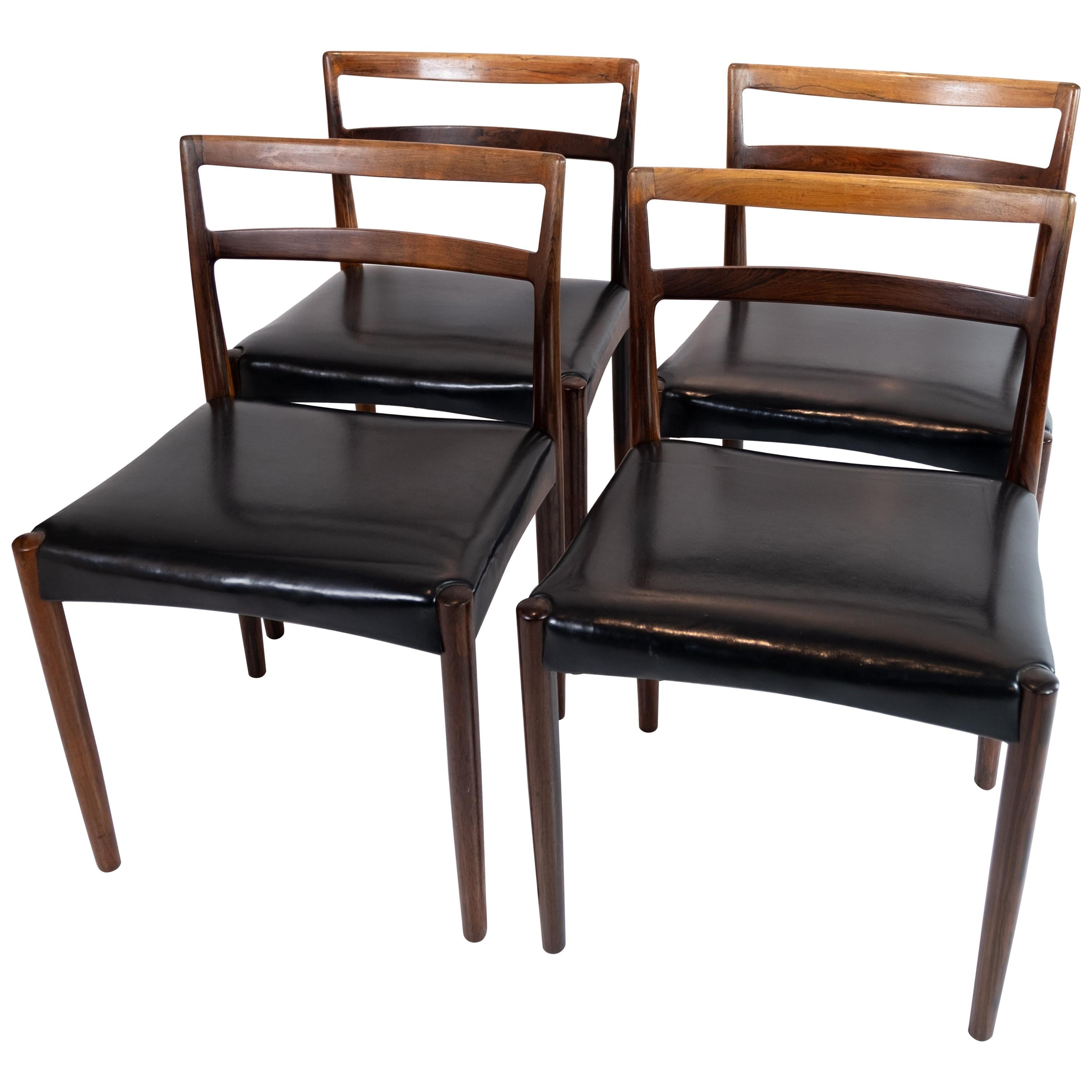 Set of Four Dining Room Chairs in Rosewood and Black Leather of Danish Design