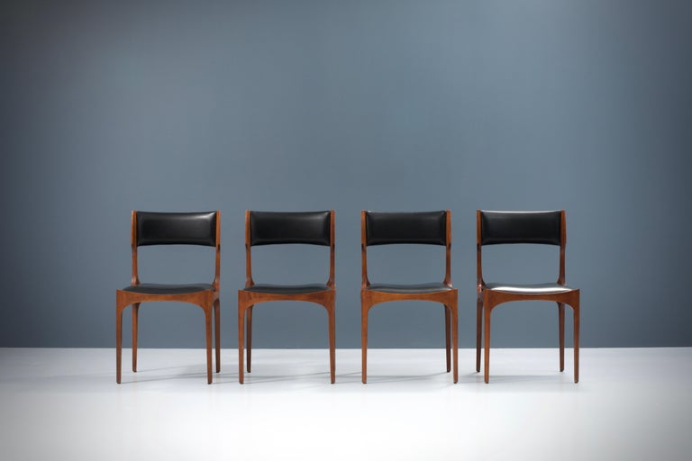 Set of four 'Elisabetta' dining chairs in beautifully patinated oak and faux leather by Giuseppe Gibelli for Fratelli Maspero, Italy, 1961, all in very good condition. The shapes of these chairs are quite distinct with its round forms and sharp